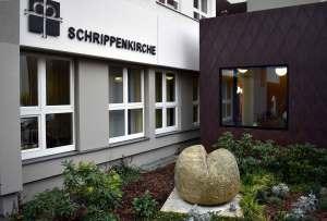 Sandsteinskulptur Schrippe vor Schrippenkirche